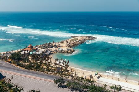 Beautiful view of Melasti Beach. Blue sea with waves, clear sky and white sand in Indian Ocean, South Kuta, Bali. Stock Photo