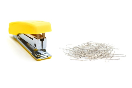 Yellow stapler and paperclips   photo