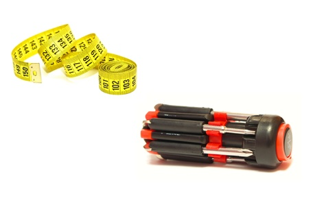 adjustable dumbbell: Universal screwdriver and measuring tape