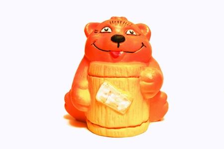 Bear with barrel of the honey   photo