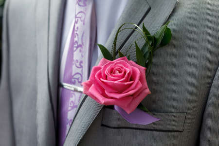 boutonniere: the grooms beautiful  boutonniere. Stock Photo