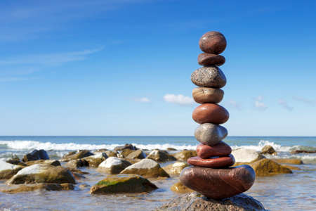 Stones balance on the sea