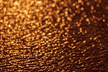 glare: the glare on the water, Golden bokeh Stock Photo