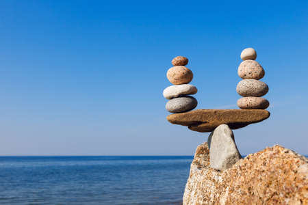 Concept of harmony and balance. Balance and poise  stones against the sea. Rock zen in the form of scales