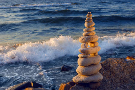 Concept of harmony and balance. Rock Zen at sunset. Balance and poise stones against the sea Stock Photo