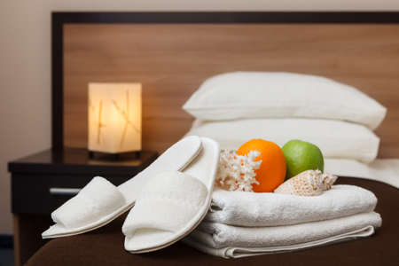 white towels and Slippers in the hotel room Stock Photo