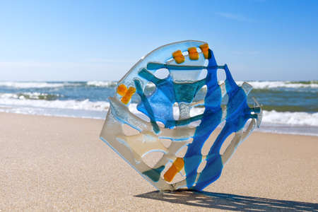 fused: Abstract composition of colored glass in the background of the sea. Fusing