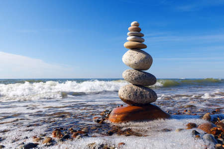 sustained: Concept of harmony and balance. Rock Zen near the sea. Balance and poise stones against the sea