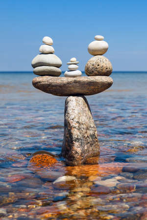 Concept of tranquility and balance. Rock zen in the form of scales