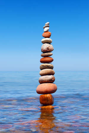parity: Concept of harmony and balance. Rock Zen in water. Balance and poise stones against the sea