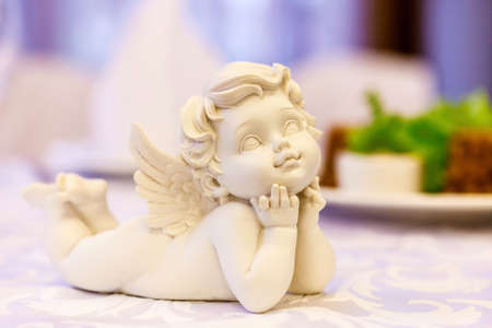 white angel figurine on the holiday table. selective focus Stock Photo