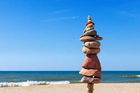 Concept of harmony and balance. Rock Zen on the beach