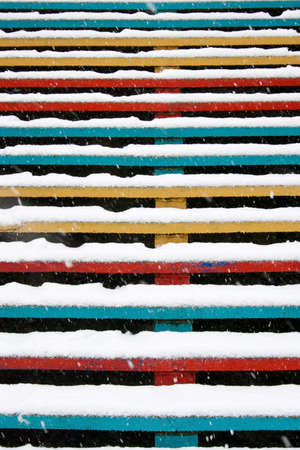 covered in snow: colorful stairs covered with snow. Winter snowfall. Soft focus, selective focus