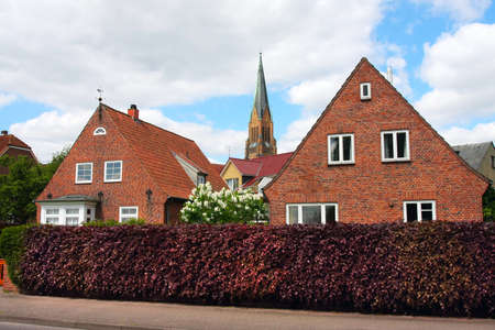 pavers: Schleswig, Germany-may 21, 2008:Street of the old town with small houses with tiled roofs. Fishing village the Hill Editorial