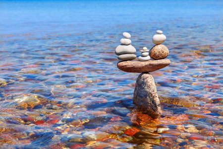 symbolic scales of standing stones in the water. balance and serenity concept