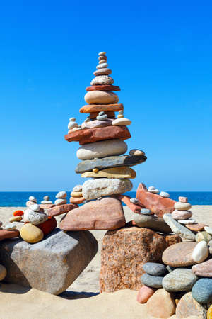 Big Rock Zen on the background of summer sea. Concept of harmony and balance. Stock Photo
