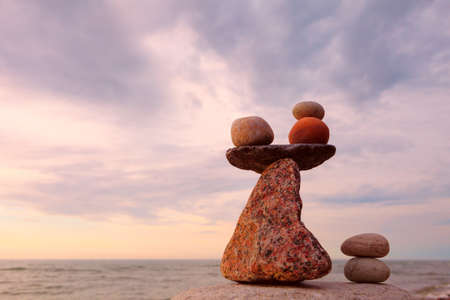 sustained: Balance stones against the sea. Rock zen in the form of scales