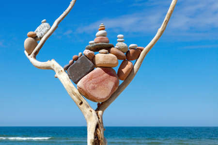 sustained: Balance and poise stones. Rock zen on the background of blue sky and sea