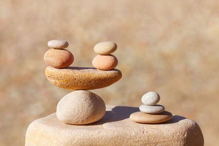 Symbolic scales of stones on blurred background. Concept of harmony and balance. Pros and cons concept. Soft focus, selective focus