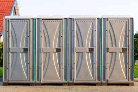 Group of four bio latrines on the street