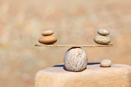Symbolic scales of stones . Concept of harmony and balance. Pros and cons, work - life concept. Soft focus, selective focus