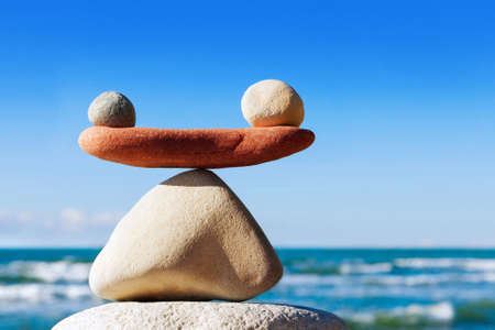 Concept of harmony and balance. Balance stones against the sea. Rock zen in the form of scales Stock fotó - 97676724