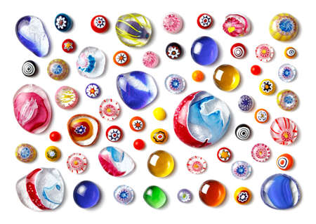 Collection of colorful glass beads of different sizes and shapes. Colored Venetian, Murano glass, millefiori. Isolated on white background. Flat lay, top view