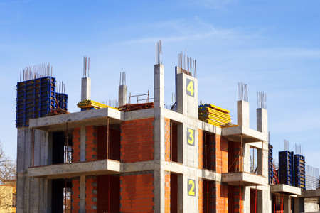 process of building a multi-storey building. construction site. numbering of the floors. The concept of growth and movement
