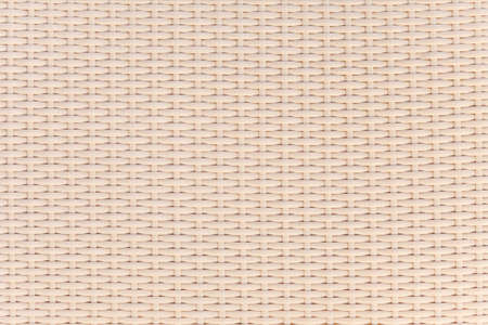 Light beige surface of woven bamboo. Background image, texture