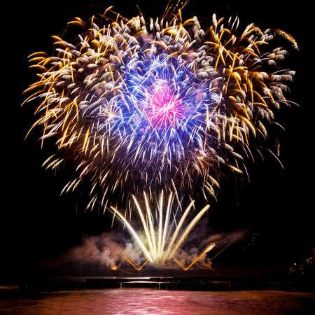 Festive fireworks of golden color on a black sky background
