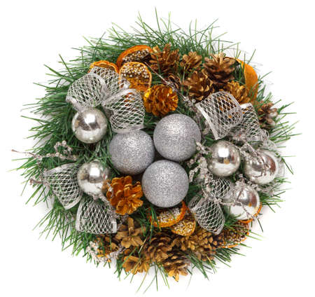 Christmas wreath of cones, silver balls and fir branches isolated on white background. New year decorations, top view