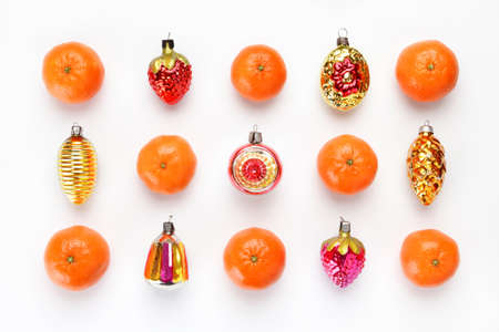 Pattern of antique Christmas toys and tangerines on white wooden surface. Christmas and new year concept. Flat lay, top view