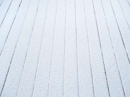 Wood boards covered with natural frost. Background image, texture, copy space