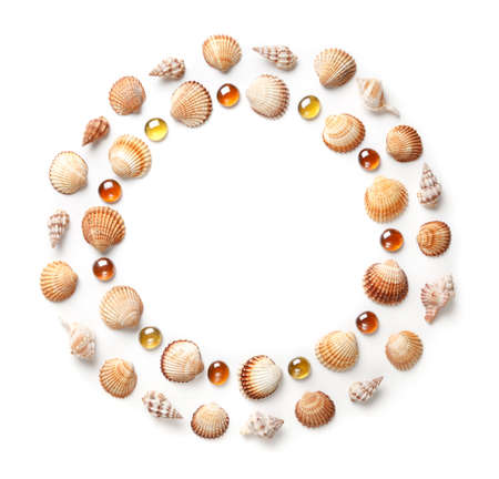 Pattern of shells and orange glass beads in the shape of a circle. Frame or design element. isolated on white background. Flat lay, top view. copy space