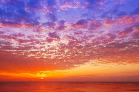 Beautiful, orange-pink sunset over the sea. Background image