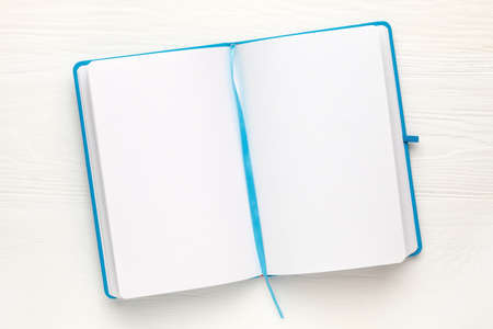 Open Notepad with clean sheets on white background. Notebook , copy space, top view