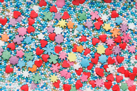 Multicolored Sugar sprinkle dots, decoration for cake. background image, texture. Flat lay, top view Stockfoto