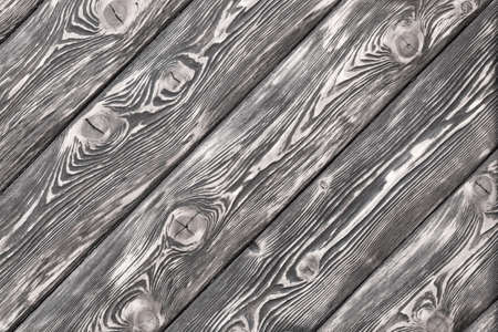 surface is very textured of old brushed boards covered with stain. White Wood background, texture. copy space
