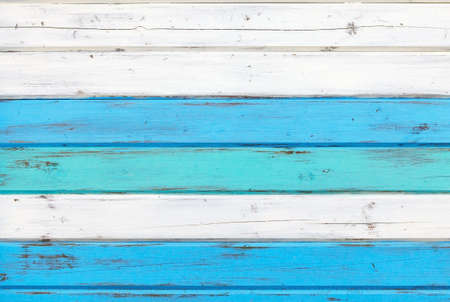 Surface of the old boards painted in white and blue. background image, texture