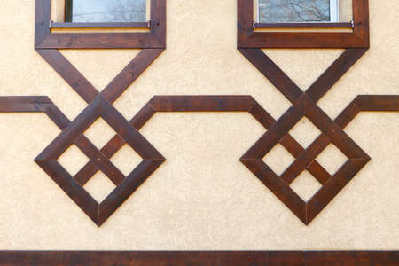 Modern wooden design of the facade of the building. Pseudo half-timbered houses
