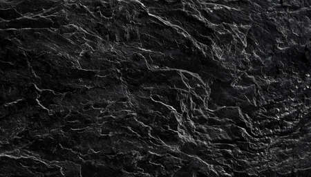 Beautiful, textured surface of black Silesian slate close-up. Background image, texture