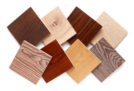 group of eight small samples of wooden parquet from different types of wood, different colors and textures for the designers work. isolated on white background. Flat lay, top view