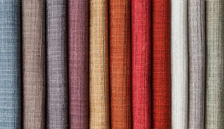 samples of multi-colored fabrics for curtains close-up. Selection of fabric for interior decoration Stockfoto