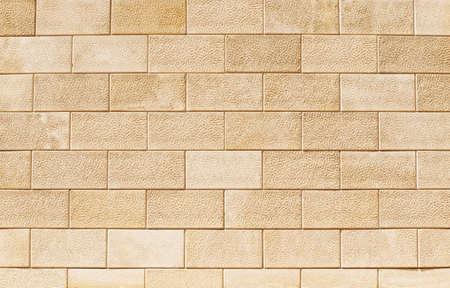Wall of flat, rectangular blocks of light yellow Sandstone or shell rock. Background image, texture Stockfoto
