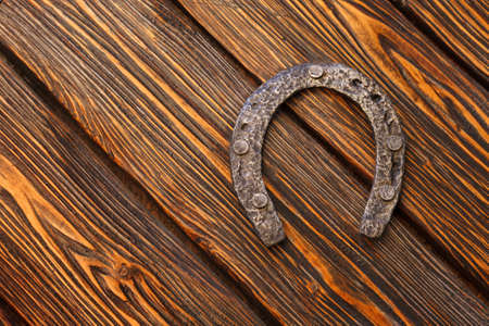 Old horseshoe on the background of beautiful, textured boards. copy space Stockfoto
