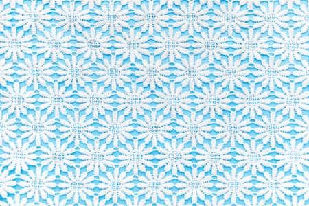 Beautiful white lace on light blue background