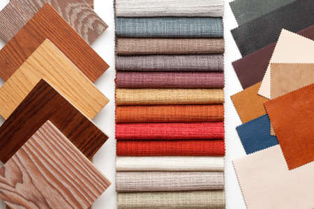 samples of parquet, fabric for curtains, and leather for the work of the interior designer. Selection of colors and materials for home decoration