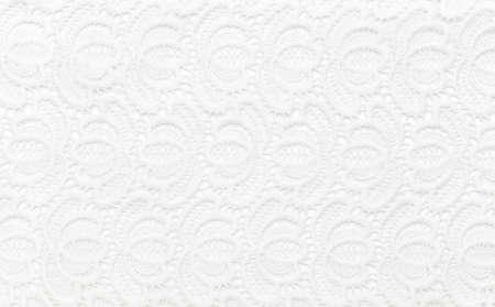 Beautiful white lace on white background. Background image, texture Imagens