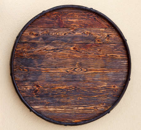 Old barrel made of wood with beautiful texture. Top view. barrel as a wall decoration element