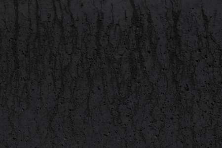 Black concrete wall with stains. Grunge background, texture